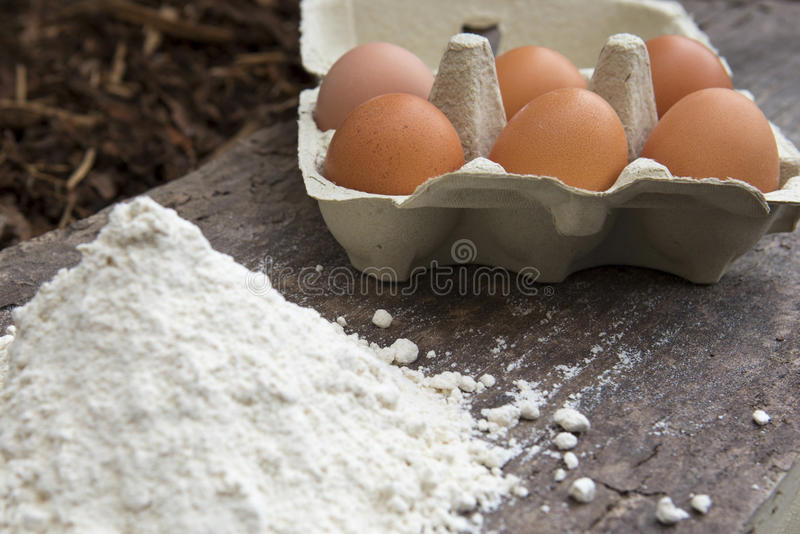 Brown eggs and flour royalty free stock photo