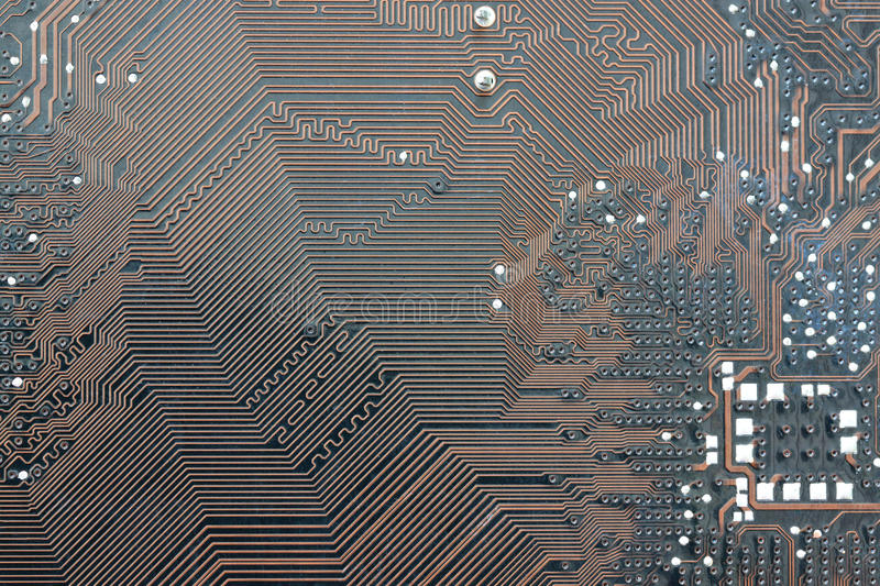 Brown electronics background of computer mainboard. Brown electronics background of computer mainboard and have concept about technology royalty free stock photos