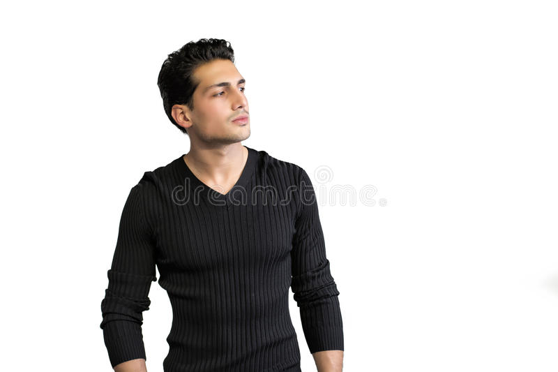 Brown eyed, black haired latin man standing on white background. Looking to a side royalty free stock image