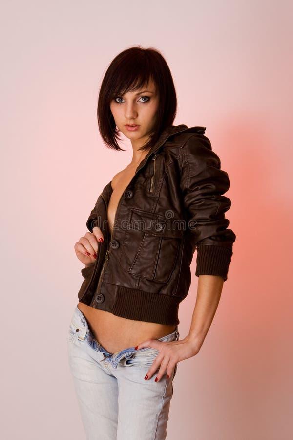 brown för flickaomslaget för brunetten gulligt barn för läder arkivfoton
