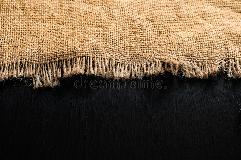 Brown fabric burlap texture on dark wood table stock images