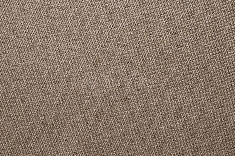 Brown fabric texture of sackcloth. Clothing background. Cloth backdrop. Pattern of sacking, bagging. Linen fabric surface close-up.  stock photography