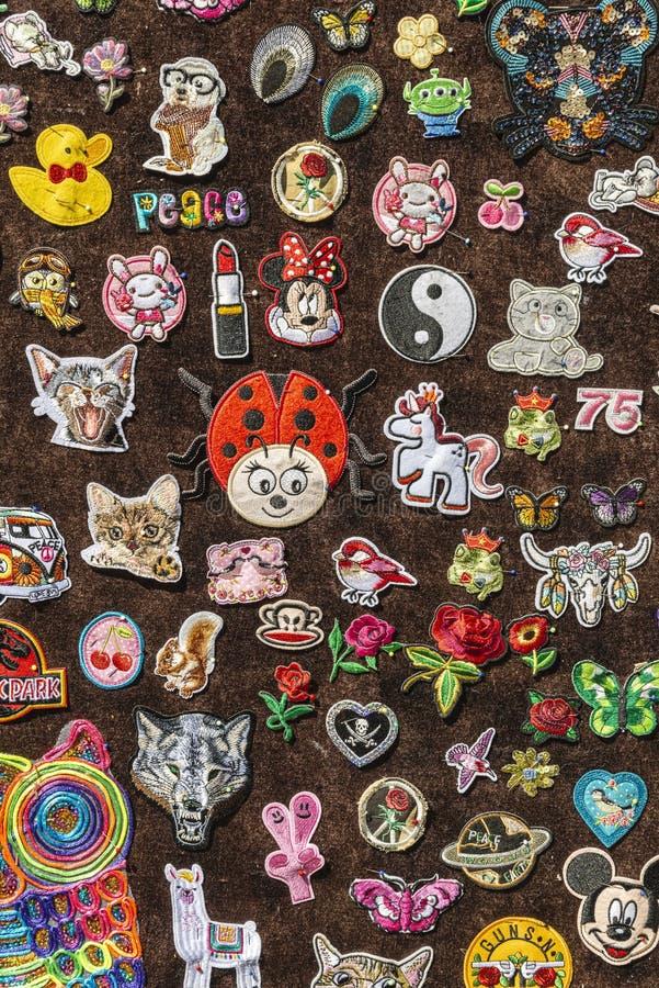 Brown felt full of various pins of various figures. Brown felt full of various pins of various cartoon and Disney figures stock photos