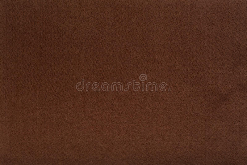 Brown felt tissue cloth, closeup texture background. Macro shot of brown felt tissue cloth, closeup texture background with details in structure stock photo