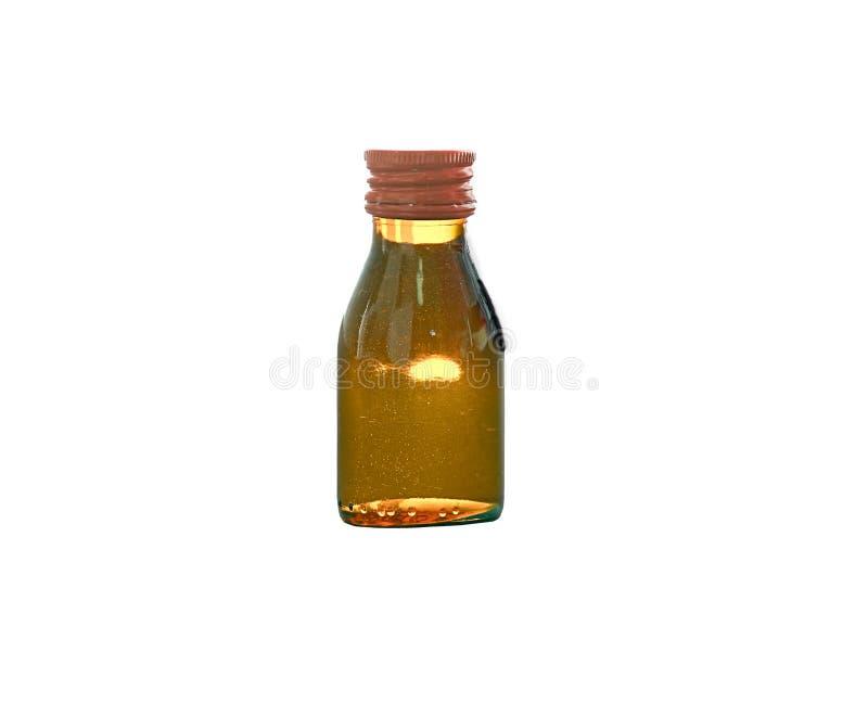 Brown-Flasche mit Flüssigkeit nach innen auf lokalisiertem weißem Hintergrund stockfotografie