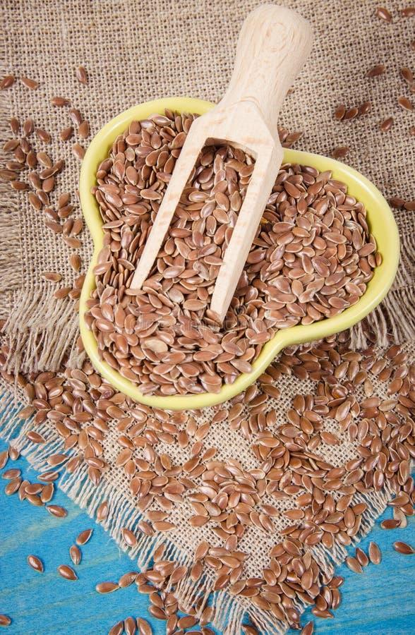 Brown flaxseed, żywność organiczna dla zdrowego łasowania obraz royalty free