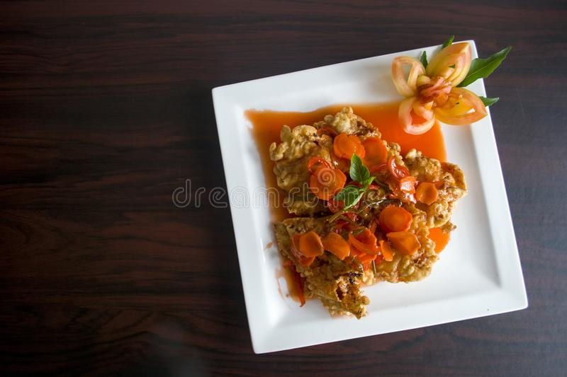 Brown Fried Food With Orange Soup on Ceramic Plate royalty free stock photos