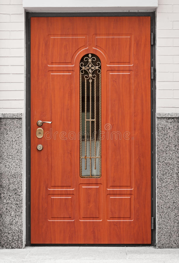 Brown front door - entrance to the building stock photography