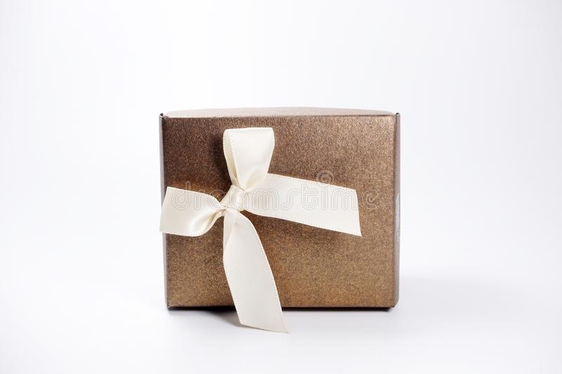 Brown gift box over white background royalty free stock photo