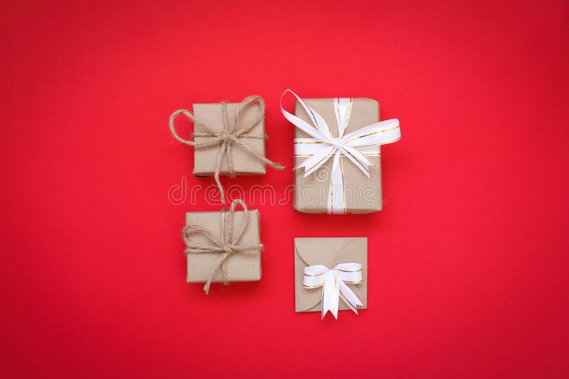 Brown gift box on red background. Four brown gift box on red background royalty free stock photo