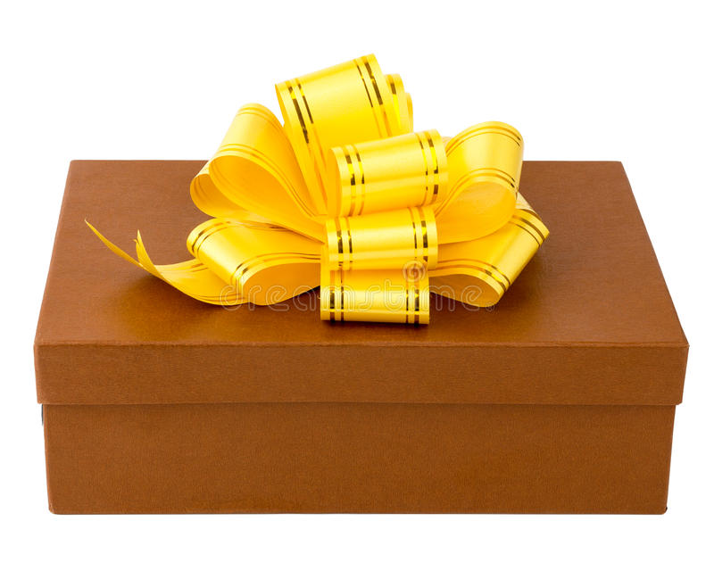 Brown gift box with yellow ribbon and bow. Isolated on white stock photo