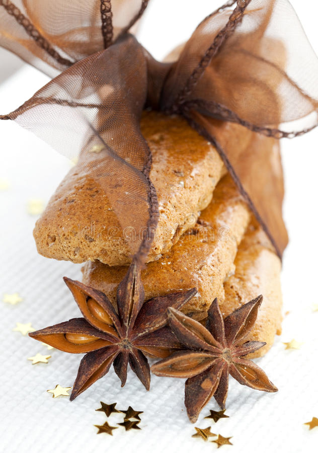 Brown gingerbread. Gingerbread with bow and anise stock image