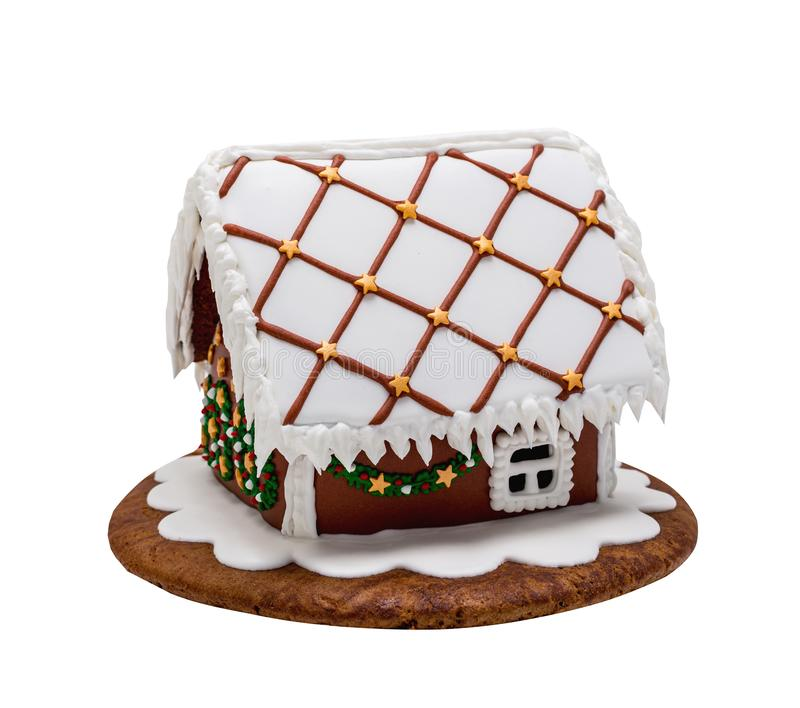 Brown gingerbread house, Christmas. Handmade. Isolated on white royalty free stock photo
