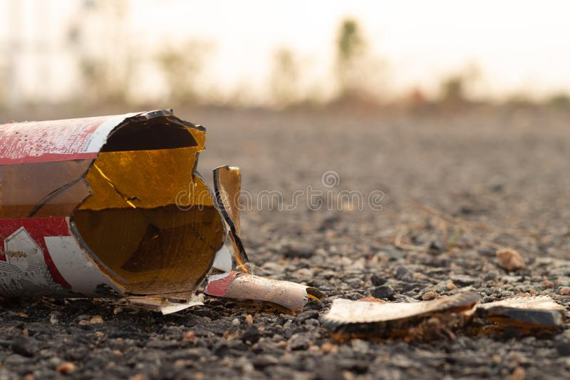 A brown glass bottle of beer broken on the floor. royalty free stock images