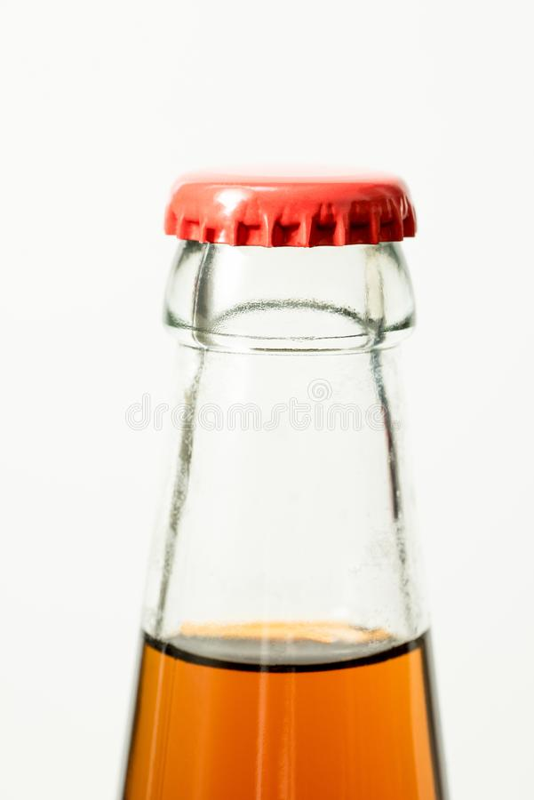 Brown glass bottle and red cap. Beer bottle stock image