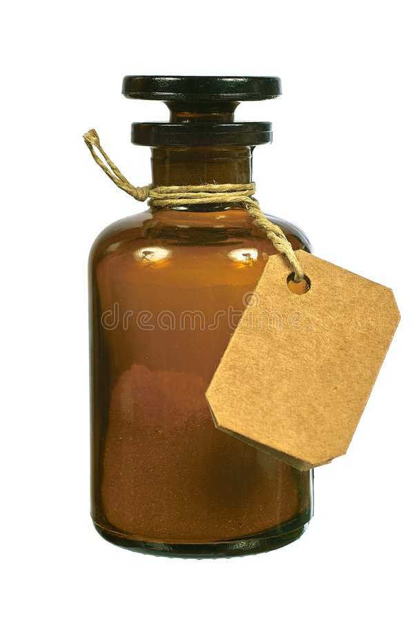 Brown glass bottle with tag stock photography