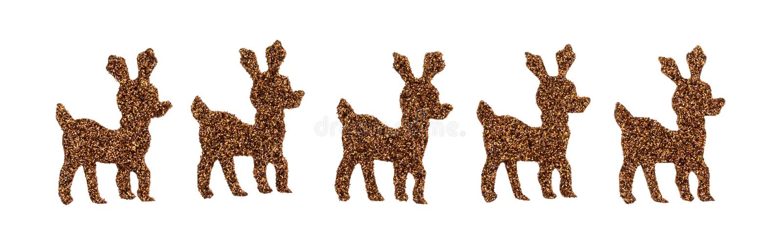 Brown glitter reindeer stickers on a white background. A row of brown glitter reindeer stickers isolated on a white background stock photos