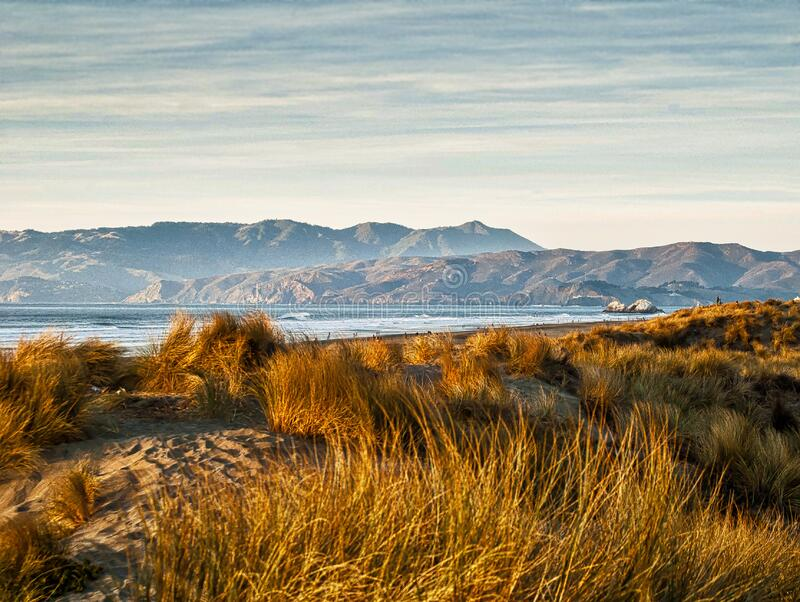 Brown Grass Near Mountains during Daytime royalty free stock photography