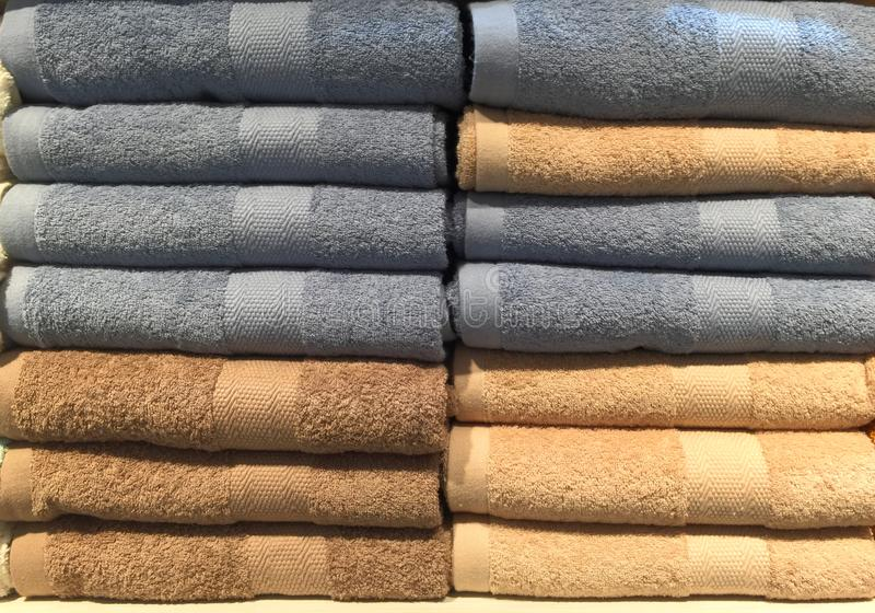 Brown and Gray Fluffy Folded Towels on a Shelf stock photos
