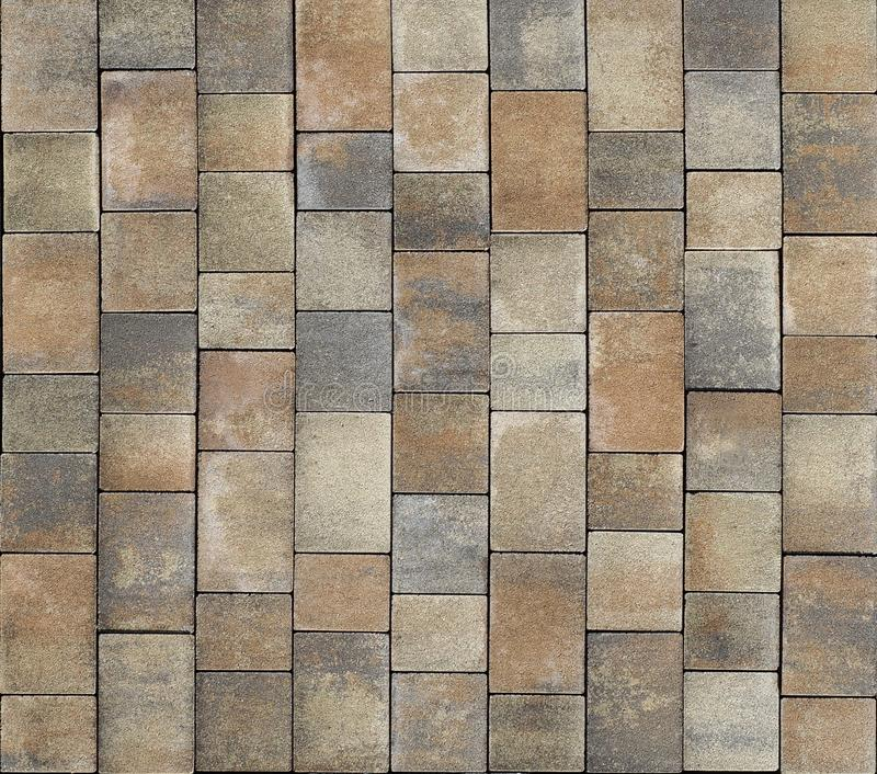 Brown and gray rustic style tiles for outdoor floor. Background and texture royalty free stock photo