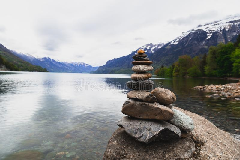 Brown and Gray Stone Stack Near Body of Water stock photo