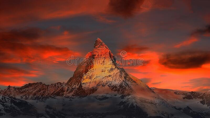 Brown and Gray White Mountain Under Cloudy Blue Sky royalty free stock image