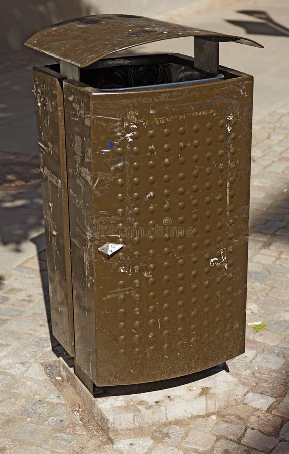 Brown and green garbage basket in Jonkoping royalty free stock photo