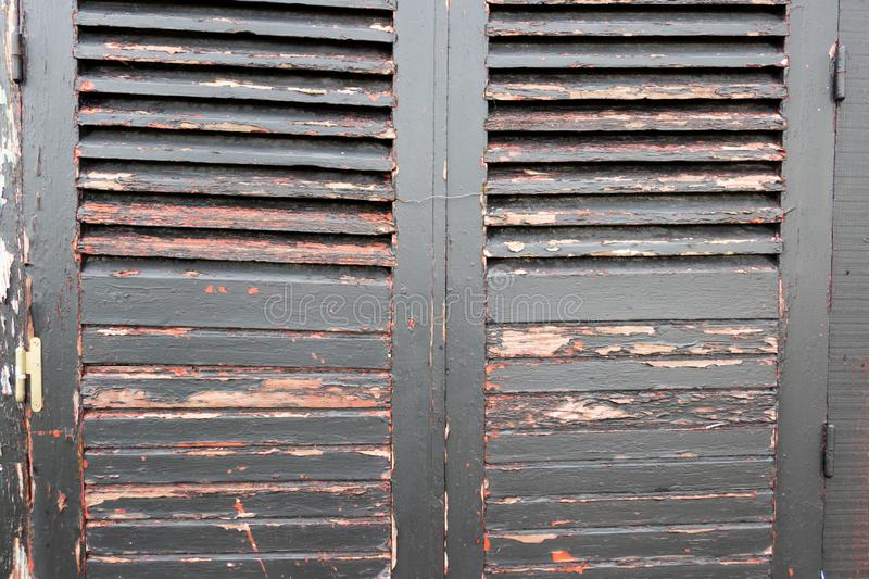 Brown grey pair of used wooden shutters for vintage background stock photography