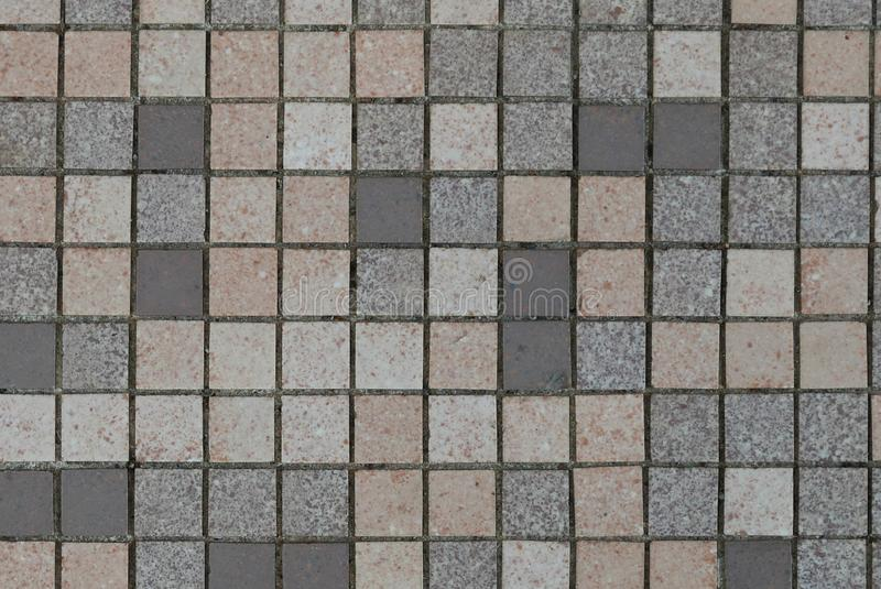 Brown,grey,white and black ceramic wall and floor tile abstract background stock image
