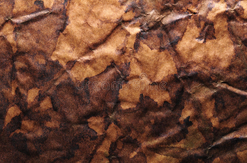 Brown grunge creased background royalty free stock photography