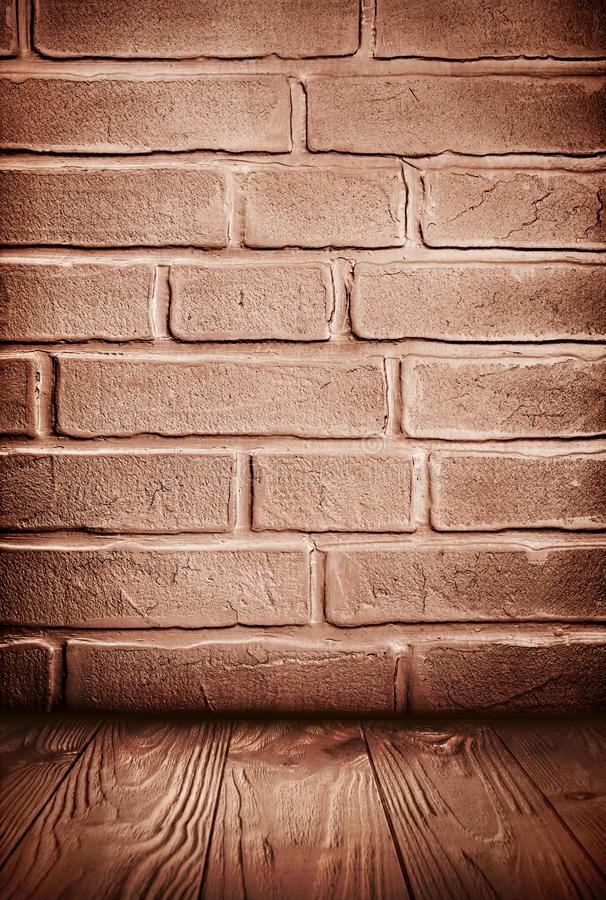 Brown grunge textured brick wall and wooden floor. With copy space stock images