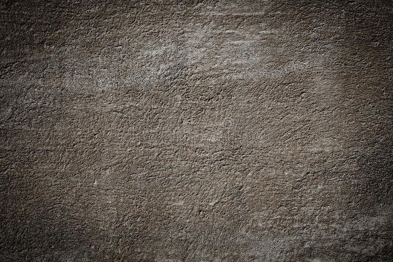 Brown grunge textured wall. With dark edges stock image