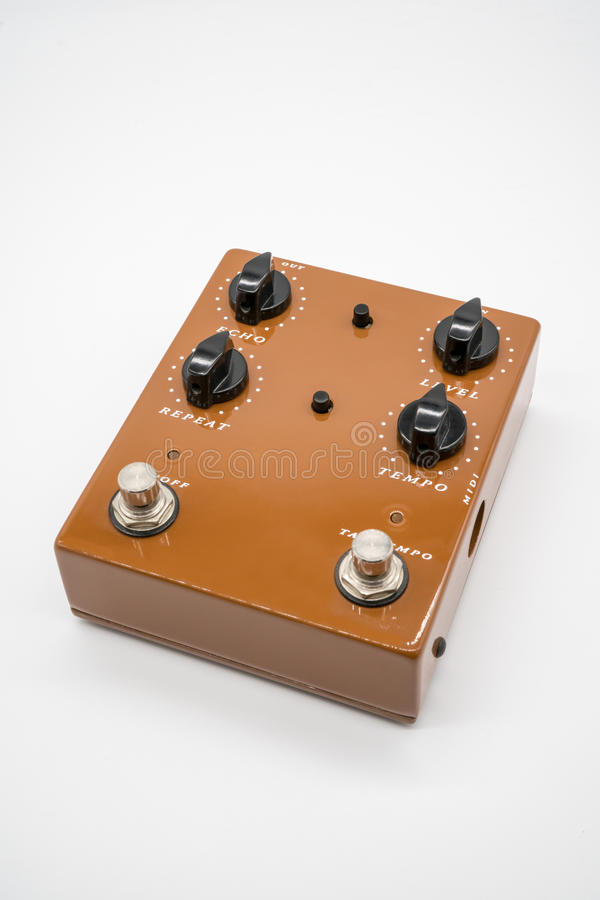 Brown guitar pedal stock photography