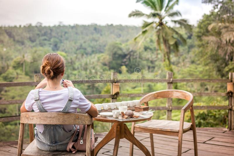 Brown-haired Woman Sitting on Brown Wooden Chair on Patio royalty free stock photos