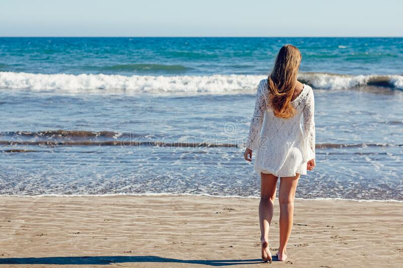 Brown Haired Woman In White Lace Long Sleeve Mini Dress Standing On Seashore Free Public Domain Cc0 Image