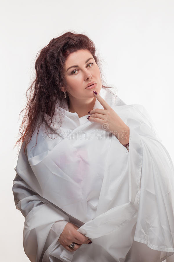 Download Brown-haired Woman In A White Sheet Stock Photo - Image: 83700818