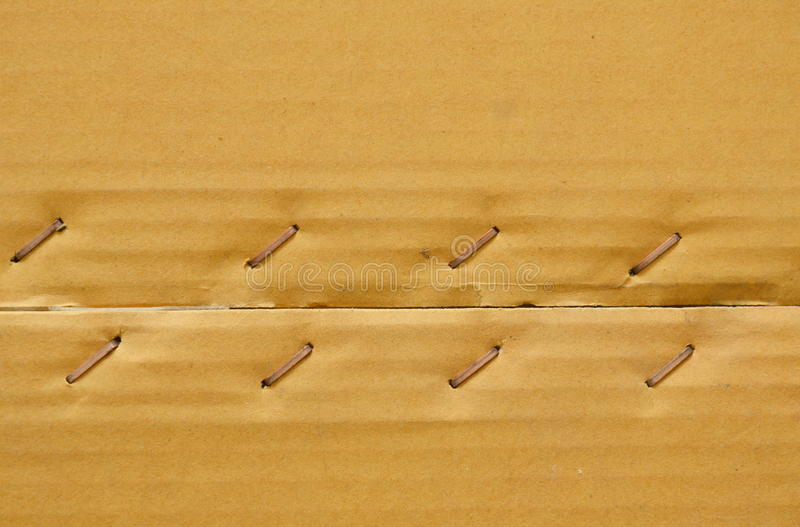 Brown hard paper box with metal wire tacked background and texture royalty free stock images