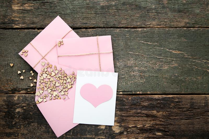 Brown hearts with envelopes stock photos