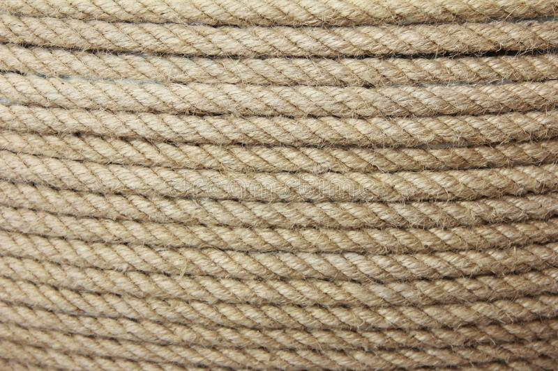 Brown hemp rope texture with fine threads. Brown hemp rope texture with fine a threads royalty free stock images