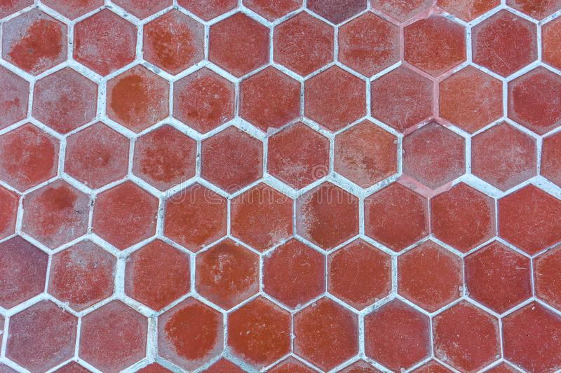Brown red hexagonal clay tiles texture background. Brown red hexagonal clay tiles texture for background stock photo