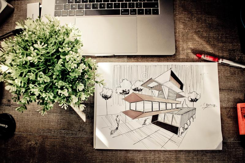 Brown House Illustration on Brown Wooden Table royalty free stock photos