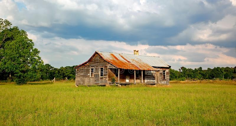 Brown House in the Middle of Green Open Field Surrounded With Trees during Daytime stock images