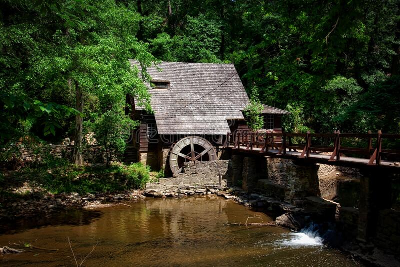 Brown House Near River Trees and Bridge royalty free stock photography