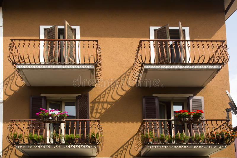 Brown house shutters decorated balconies royalty free stock image