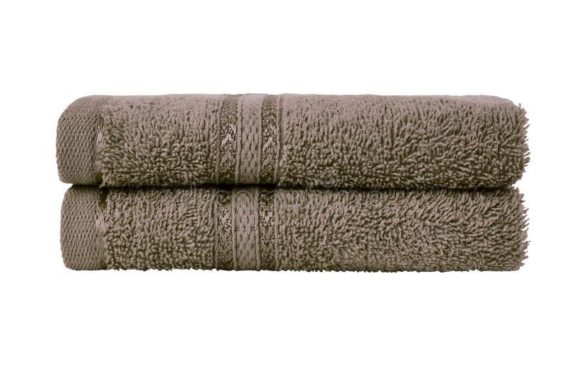 Brown kąpielowi ręczniki w stercie t?a ?cinku odosobniony lifebelt nad ?cie?ki biel zdjęcie stock