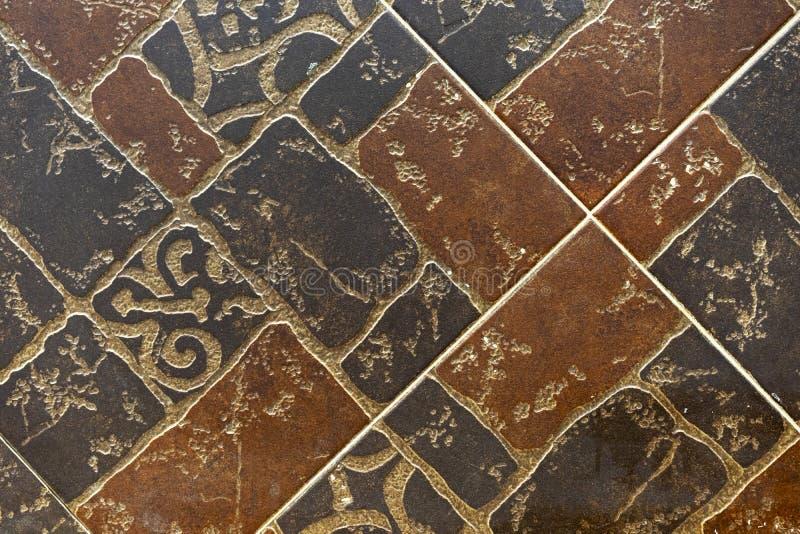 Brown-Keramikfliesen mit einem abstrakten Muster lizenzfreie stockfotografie