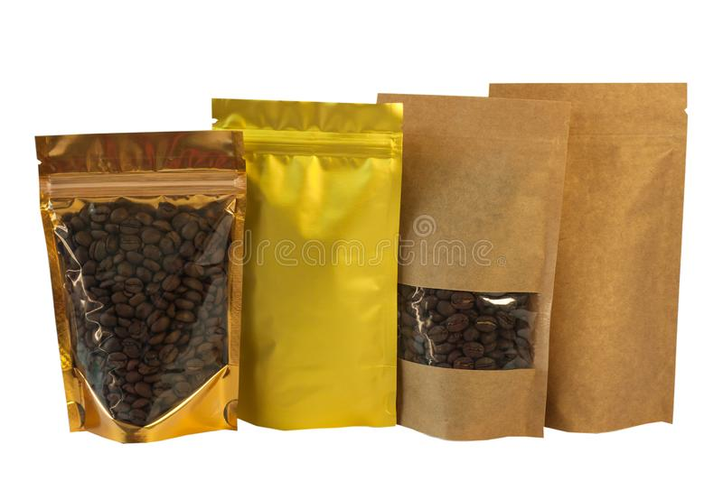 Brown kraft paper pouch bags front view isolated on a white background. Packaging for foods and goods template mock-up. Brown kraft paper and golden metallized stock image