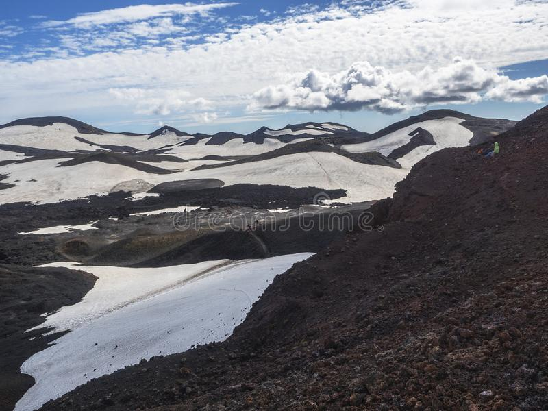 Brown lava fields and hiking trail around the volcano Eyjafjallajokull. Iceland stock photo