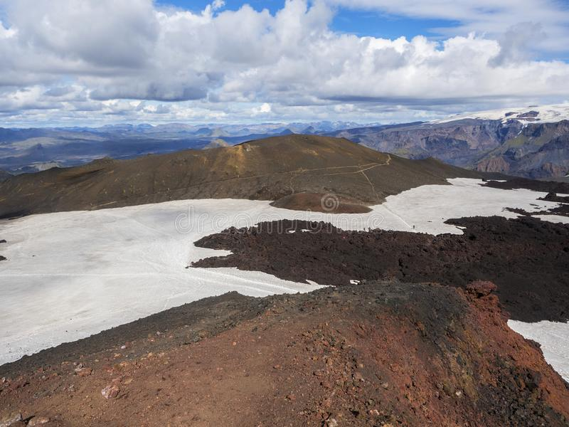 Brown lava fields and hiking trail around the volcano Eyjafjallajokull. Iceland royalty free stock photos