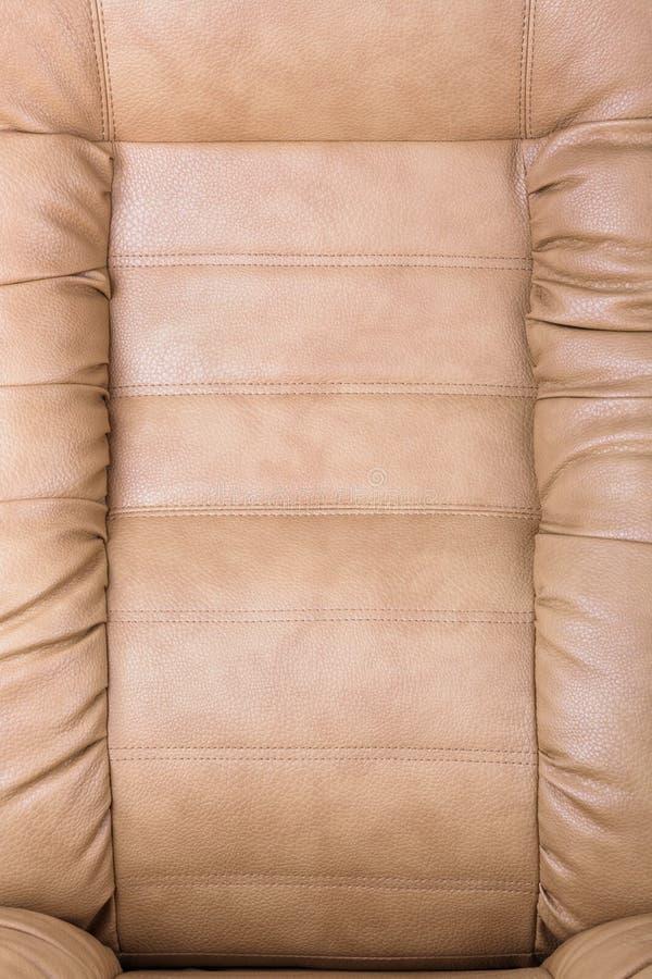 Brown leather armchair stock photos